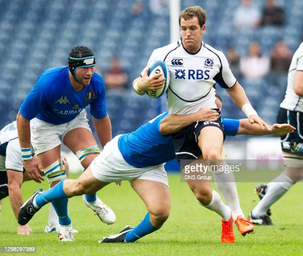 V ITALY .MURRAYFIELD - EDINBURGH.Rory Lamont, the Scotland full back, attempts to keep his footing.