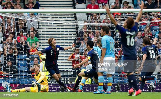 V JAPAN.HAMPDEN - GLASGOW.Japan's Yuki Otsu wheels away to celebrate his opening goal