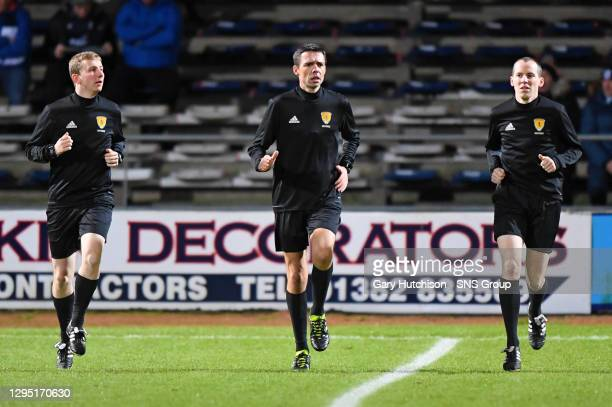 V KILMARNOCK .DENS PARK - DUNDEE .Match officials Kevin Clancy, Sean Carr and David Doig warm up ahead of kick-off.