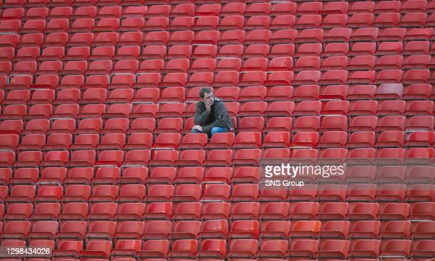 V KILMARNOCK.PITTODRIE - ABERDEEN .A lonely Aberdeen fan takes his seat in the stand