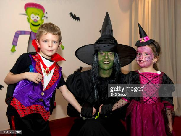 V KILMARNOCK.TYNECASTLE - EDINBURGH.Clare Cowan of Hearts gets into the Halloween spirit with young fans Dominic Jennings and Casey Turnbull
