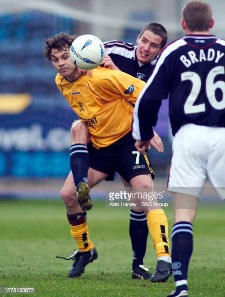 V LIVINGSTON.DENS PARK - DUNDEE.David Fernandez struggles to hold off Dundee defender Lee Mair.