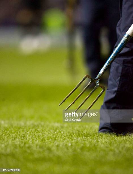 V LYON .IBROX - GLASGOW.Pitch is forked prior to the match.
