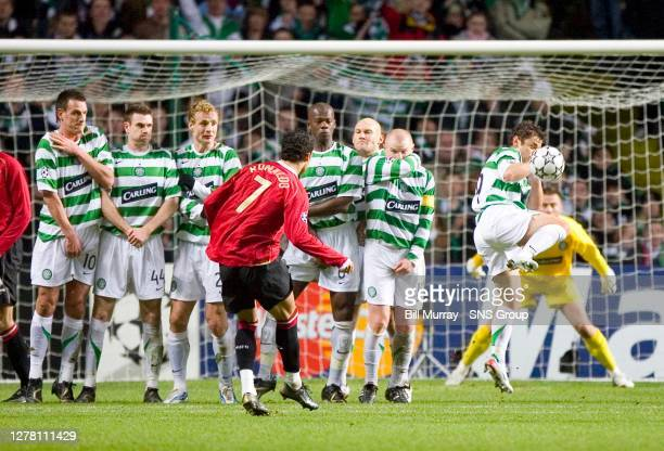 V MANCHESTER UTD .CELTIC PARK - GLASGOW .Celtic's Shaun Maloney blocks a Cristiano Ronaldo free kick only to have a penalty awarded against him for...
