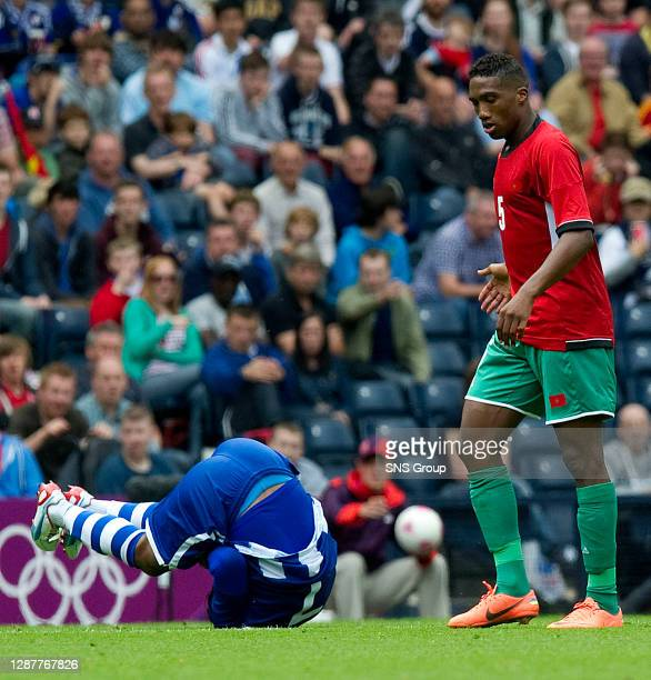 V MOROCCO.HAMPDEN - GLASGOW.Morocco's Zakarya Bergdich is sent off after leaving Mario Martinez in a crumpled heap