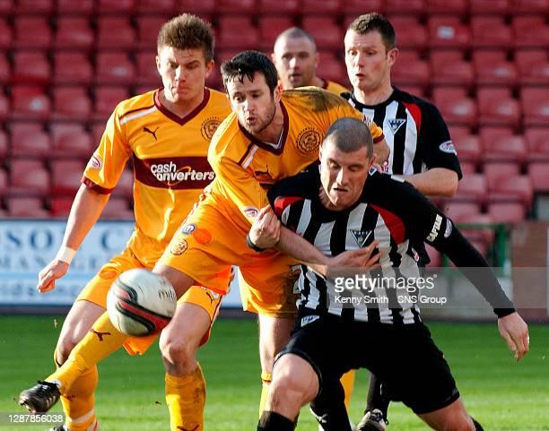 V MOTHERWELL.EAST END PARK - DUNFERMLINE.Shaun Hutchinson and Tim clancy heap pressure on Dunfermline's Austin McCann