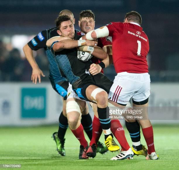 V MUNSTER .SCOTSTOUN STADIUM - GLASGOW .Glasgow Warriors' Ryan Wilson is tackled by Dave Kilcoyne