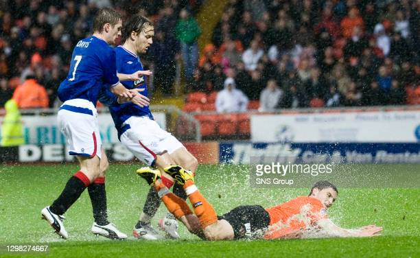 V RANGERS .TANNADICE - DUNDEE .Craig Conway splashes as he hits the ground