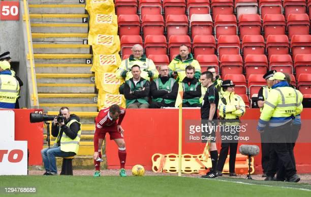 V RANGERS.PITTODRIE - ABERDEEN.Aberdeen's Niall McGinn retrieves a carton of juice from the pitch