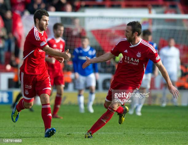 V RANGERS.PITTODRIE - ABERDEEN.Aberdeen's Rory McArdle and Richard Foster celebrate after the latter's goal gave the home side some hope