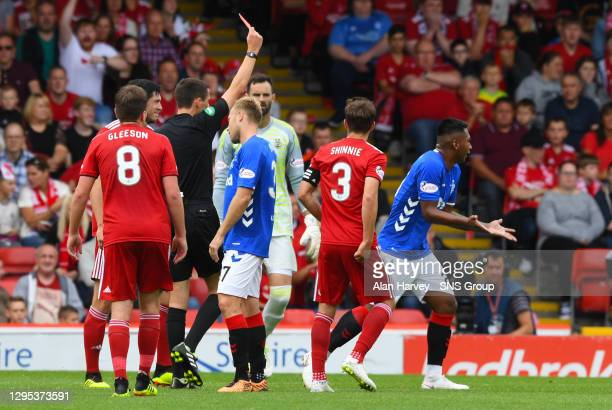 V RANGERS.PITTODRIE - ABERDEEN.Rangers' Alfredo Morelos is shown a red card by Kevin Clancy
