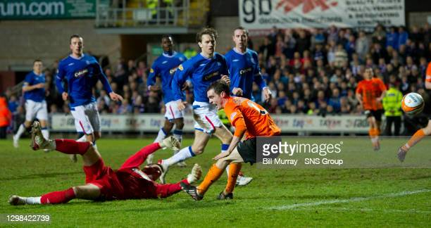 V RANGERS.TANNADICE - DUNDEE.Dundee Utd's David Robertson's bravery pays off as he pokes the ball home under the unlucky Allan McGregor to win the...