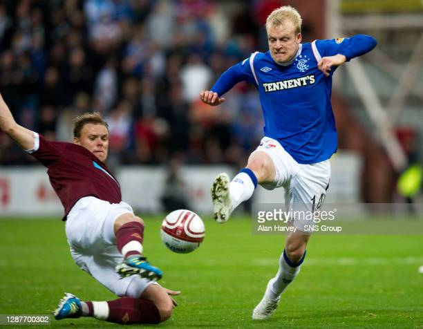 V RANGERS.TYNECASTLE - EDINBURGH.Steven Whittaker contests possession with Hearts' Adrian Mrowiec