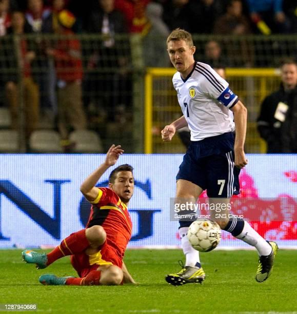 V SCOTLAND .KING BAUDOUIN STADIUM - BRUSSELS.Darren Fletcher gets away from Belgium's Dries Mertens