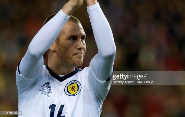 V SCOTLAND .KING BAUDOUIN STADIUM - BRUSSELS.Scotland's Kenny Miller applauds the travelling support