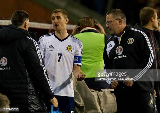 V SCOTLAND.KING BAUDOUIN STADIUM - BRUSSELS.Scotland captain Darren Fletcher has words with manager Craig LEvein and coach Jim Stewart at full-time