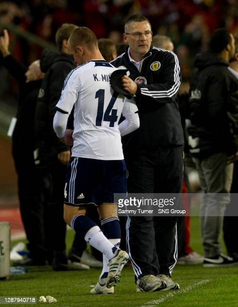 V SCOTLAND.KING BAUDOUIN STADIUM - BRUSSELS.Scotland manager Craig Levein consoles Kenny Miller at full-time