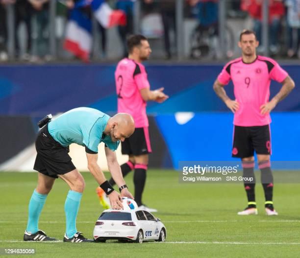 V SCOTLAND.METZ - FRANCE.The match ball arrives via remote control car