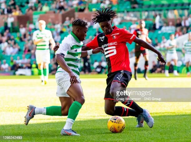 V STADE RENNAIS.CELTIC PARK - GLASGOW.Celtic's Karamoko Dembele takes on Eduardo Camavinga