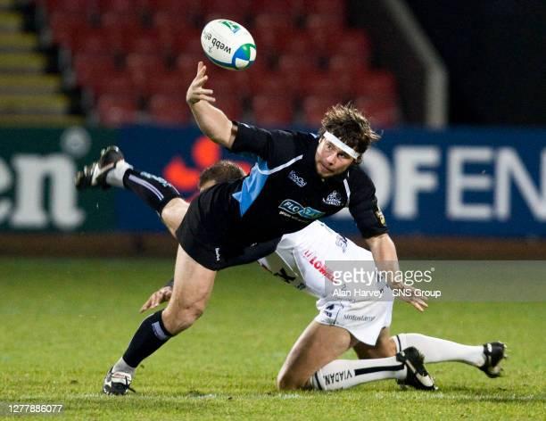 V VIADANA .FIRHILL - GLASGOW.Glasgow Warriors centre Scott Barrow is challenged by opposite number Roberto Talloti