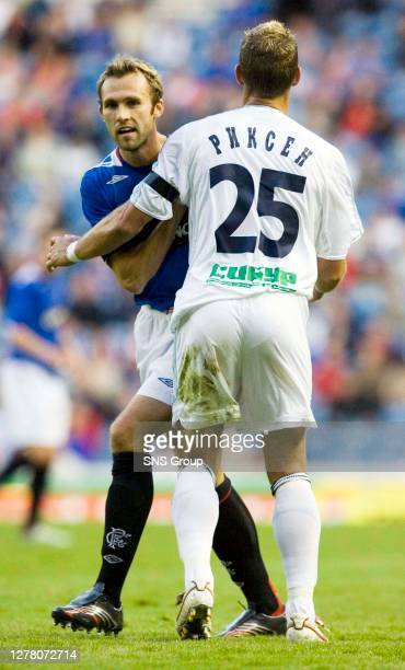 V ZENIT ST PETERSBURG .IBROX - GLASGOW .Fernando Ricksen shows off the Russian spelling of his name as he gets to grips with Rangers star Thomas...