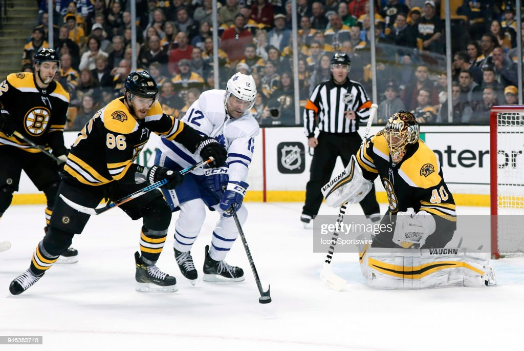 ]v12] pressured by Boston Bruins right wing David Pastrnak (88) in front of Boston Bruins goalie Tuukka Rask (40) during Game 2 of the First Round for the 2018 Stanley Cup Playoffs between the Boston Bruins and the Toronto Maple Leafs on April 14, 2018, at TD Garden in Boston, Massachusetts. The Bruins defeated the Maple Leafs 7-3.