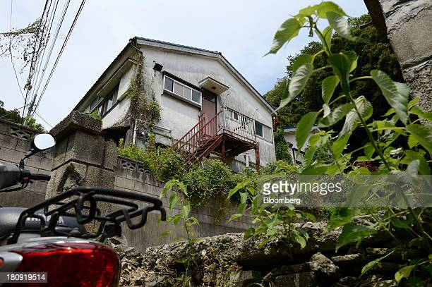A vacant house stands in the Yato area of Yokosuka City Kanagawa Prefecture Japan on Wednesday Aug 21 2013 More than 50 houses and apartments almost...