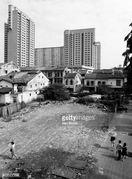 Vacant lot awaits redevelopment after shophouses were demolished along New Bridge Rd from Pagoda St to Temple St Chinatown Singapore 12 July 1983 The...