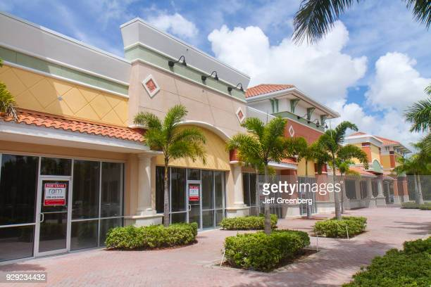 Vacant stores for lease at a strip mall in Estero