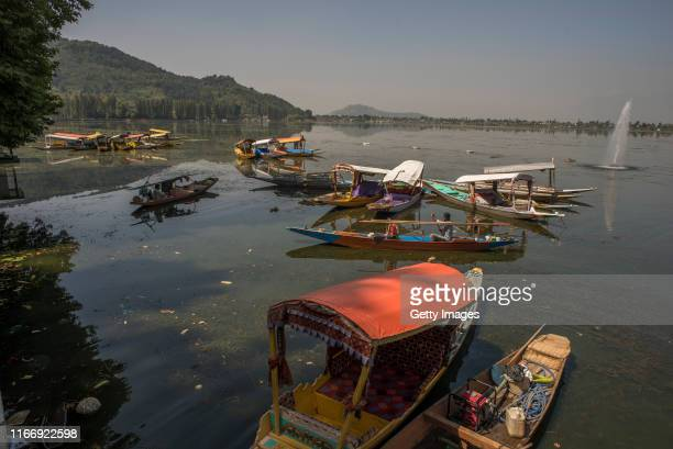 Vacant tourist Shikara boats are moored in middle of Dal lake during curfew like restrictions on September 09 2019 in Srinagar the summer capital of...