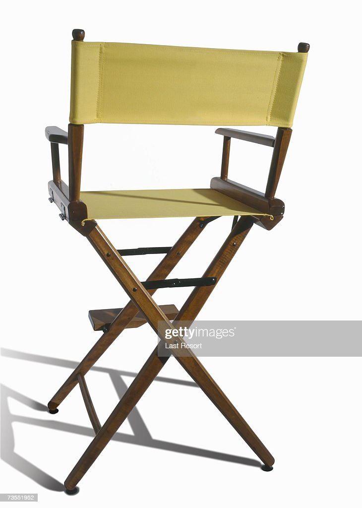 Vacant yellow directors chair on white background : Stock Photo
