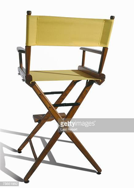 vacant yellow directors chair on white background - cadeira de diretor - fotografias e filmes do acervo