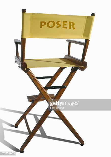 Vacant yellow directors chair with name poser on it on white background