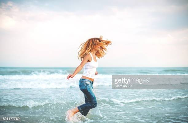 vacation at the sea - wet jeans stock photos and pictures