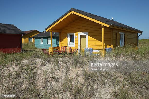 Vacation bungalows for rent stand on Duene Island on August 4 2013 near Helgoland Germany Duene Island was once an extension of neighboring...