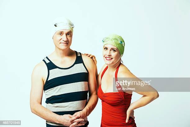 Vacation couple wearing retro bathing cap swimsuit