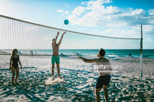 vacation fun - beach volleyball stock pictures, royalty-free photos & images