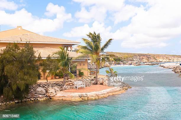 vacation home on a man made lagoon - curaçao stockfoto's en -beelden