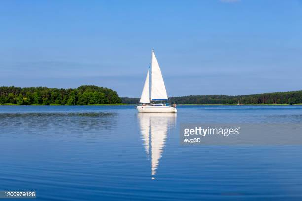 vacation in poland - sailboat on the niegocin lake, masuria - sailboat stock pictures, royalty-free photos & images