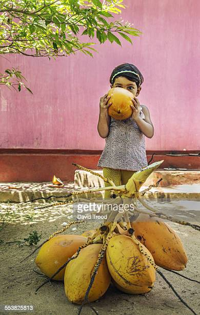 vacation in Sri LankaYoung child drinking from a f