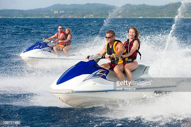 Vacation Lifestyles-Friends Riding Jet Skis Together