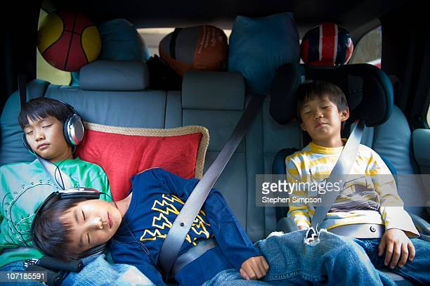Vacation road trip, brothers sleeping in back seat