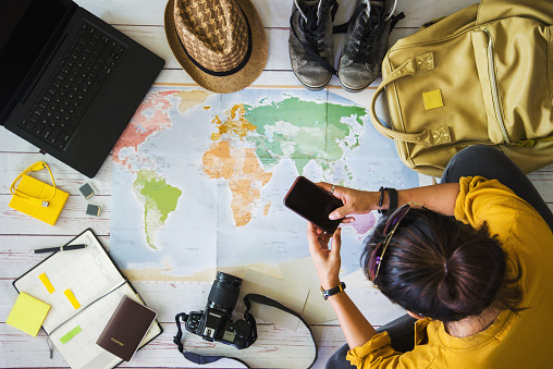 Vacation travel planning concept with map. Overhead view of equipment for travelers. Travel concept background, young Asian woman. Travel holiday, summer. 1153172006