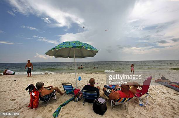 Vacation turnout on the beach at Gulf Shores, Alabama was good, partly due to the money–back guarantees offered to visitors. BP gave millions of...