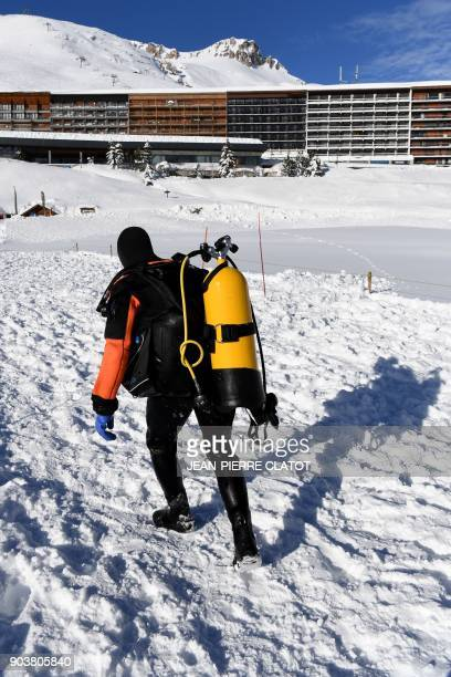 A vacationer wearing special equipment leaves after ice diving at minus two degrees Celsius in the frozen lake of Val Claret in the French Alps ski...