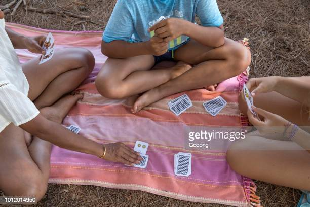 Vacationers playing cards in Salento Italy