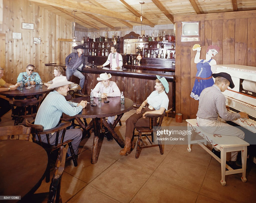 Vacationers relax in the bar at the Gay El Rancho resort  News Photo