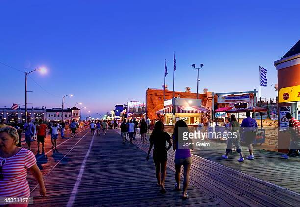 Vacationers strolling along the boardwalk in summer.