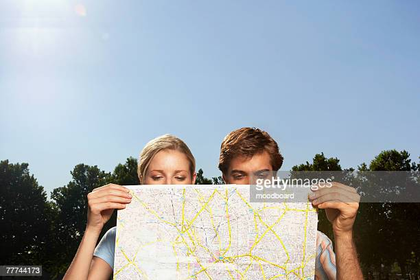 Vacationing Couple Consulting Map