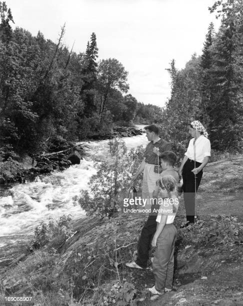A vacationing family from New York with a catch of speckled trout from the stream Oba Ontario late 1950s